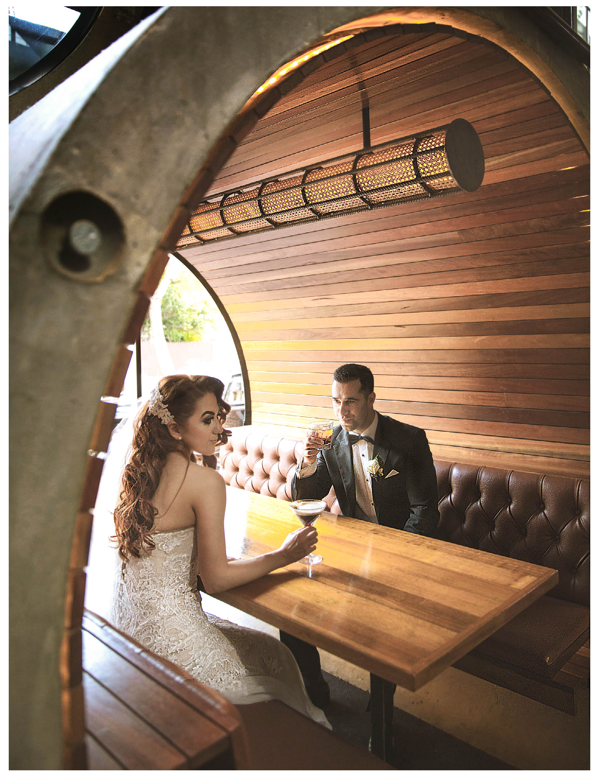Bride and Groom take photos in a coffee